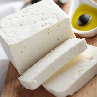 Cheese next to olive oil