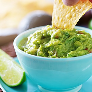 Chip in guacamole dip